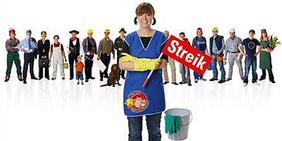 Gebäudereinigerin mit Streikfahne vor Handwerks-Kollegen